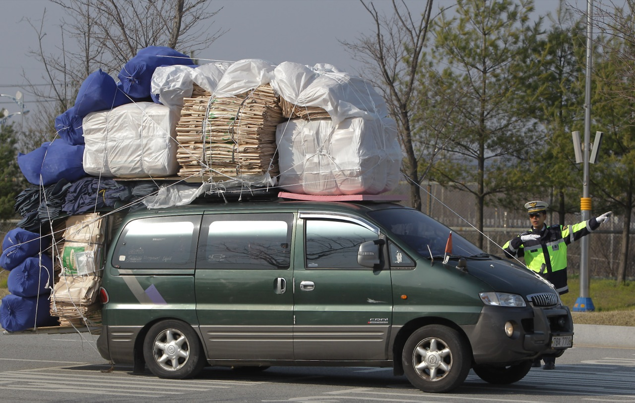The Overloaded Cars Of South Korean Workers Fleeing North
