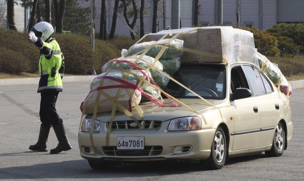 The overloaded cars of South Korean workers fleeing North ...
