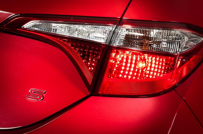 new-2014-toyota-corolla-teased-in-red-photos-from-toyota-canada-medium