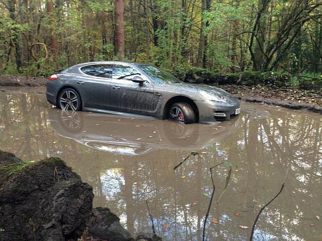 footballer-gets-porsche-panamera-stuck-in-muddy-woods-by-blindly-following-navigation-medium_2