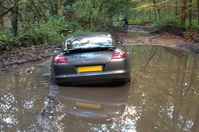 footballer-gets-porsche-panamera-stuck-in-muddy-woods-by-blindly-following-navigation-medium_4