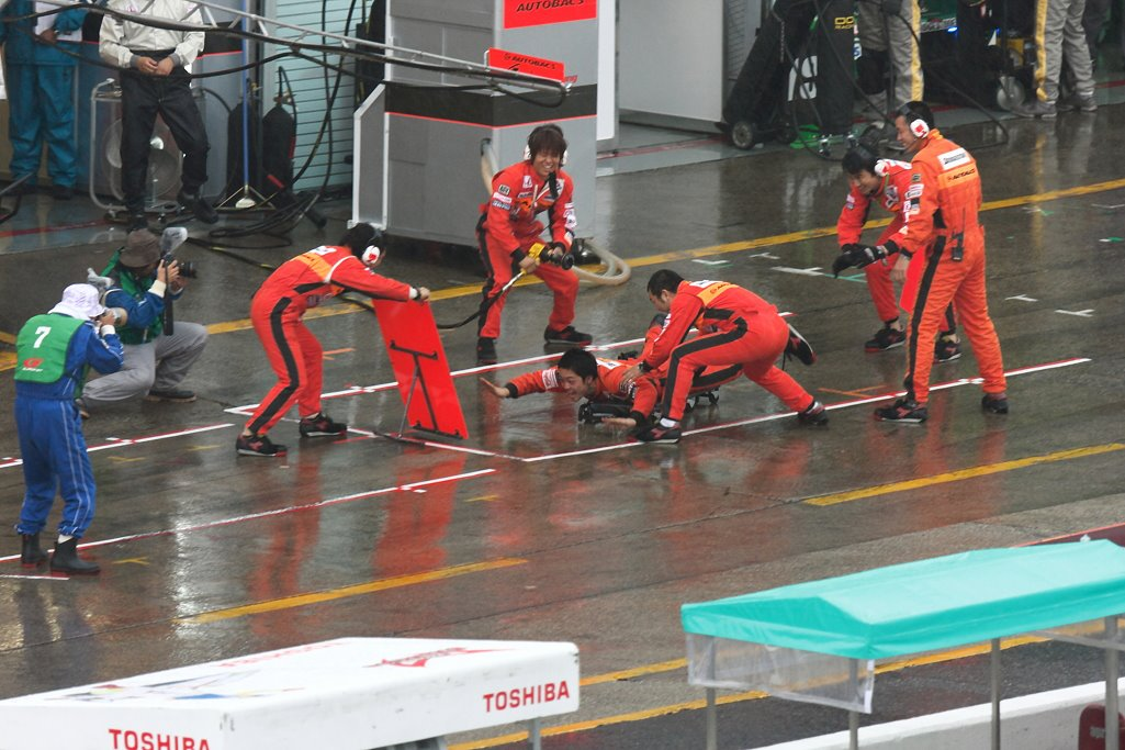 Pit crew having fun