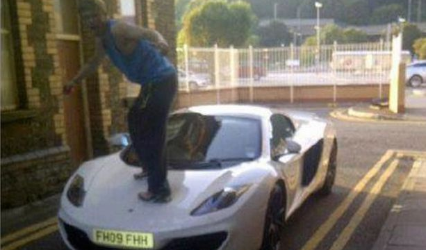 Boy Jumping On A McLaren's Bonnet