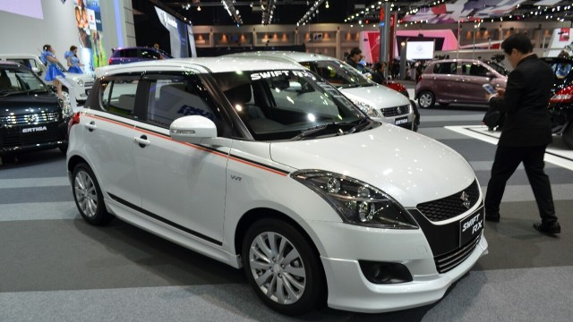 2015-Suzuki-Swift-RX-front-three-quarters-left-at-the-2014-Thailand-International-Motor-Expo