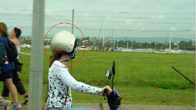 woman wears helmet backwards