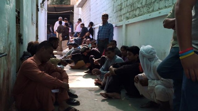 People made to sit on the floor out in corridor as the branch goes on a lunch break. Xermesh Patel, Facebook.
