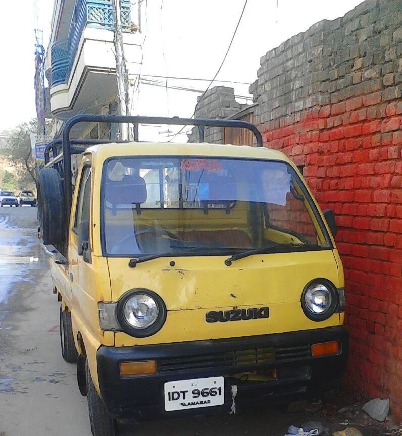 Taxi-1993-Suzuki-Carry-yellow-cab
