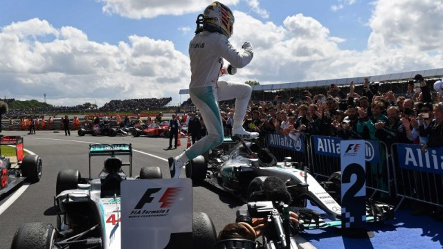 Lewis Hamilton jumping from his car