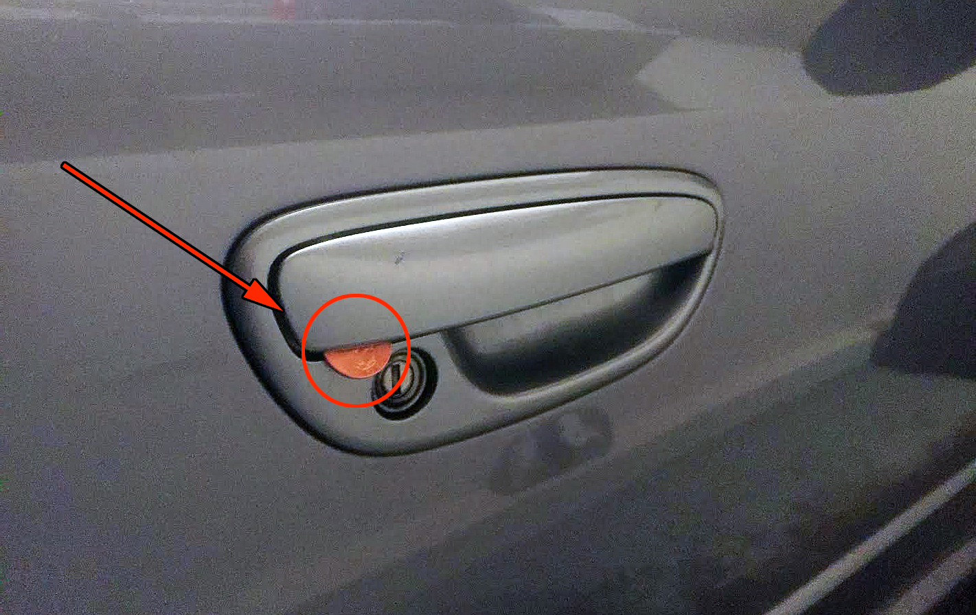 Coin on door handle