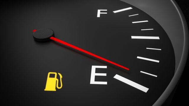 Empty fuel warning light in car dashboard. 3D rendered illustration.