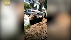 Chinese man buried in his car